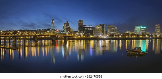 Portland Oregon Downtown Skyline with Hawthorne Bridge Along the Banks of Willamette River at Evening Blue Hour Panorama