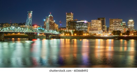 Portland Oregon downtown skyline night panoramic view with Hawthorne Bridge.