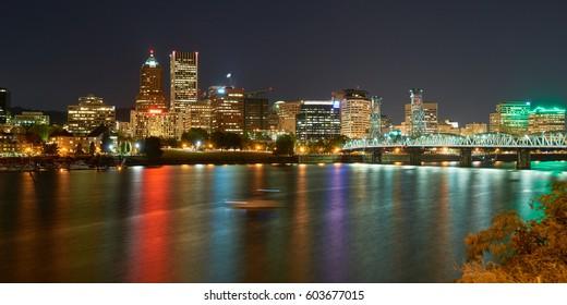 Portland Oregon downtown skyline night panoramic view with Hawthorne Bridge.