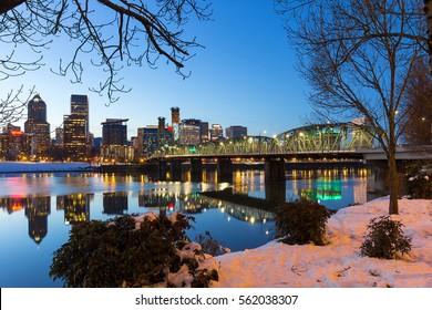 Portland Oregon downtown snow on the banks of Willamette River winter night scene