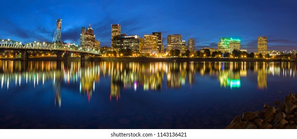 Portland Oregon Downtown Waterfront City Skyline by Hawthorne along Willamette River during Blue Hour Panorama