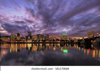 Portland Oregon Downtown Waterfront City Skyline with Reflection on Willamette River After Sunset
