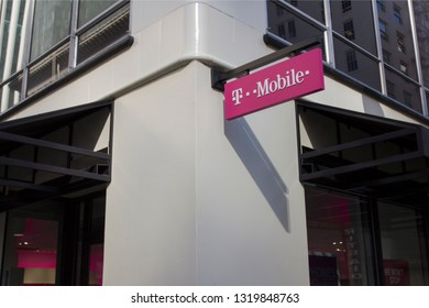 Portland, Oregon - Feb 21, 2019: The sign of T-Mobile at a T-Mobile store in downtown Portland.