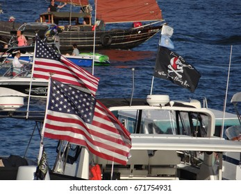 PORTLAND, OREGON - JUL 1, 2017 - Pleasure boats at anchor with American flags on the  4th of July weekend Blues festival in  Portland,  Oregon