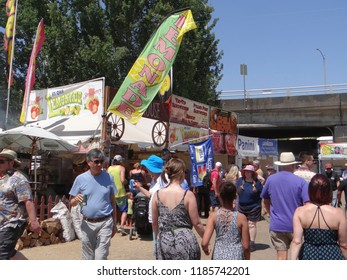 PORTLAND, OREGON - JUL 5, 2018 - Music fans visit the food stalls at the Waterfront Blues Festival, Portland, Oregon