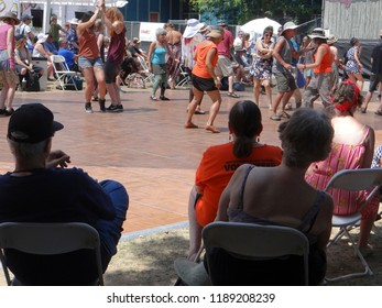 PORTLAND, OREGON - JUL 5, 2018 - Visitors watch dancers and zydeco music, Waterfront Blues Festival, Portland, Oregon