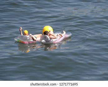PORTLAND, OREGON - JUL 5, 2018 - Rafters relax on the Willamette River during the Waterfront Blues Festival, Portland, Oregon