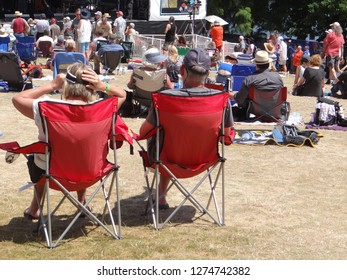 PORTLAND, OREGON - JUL 5, 2018 - Music lovers relax in lawn chairs while listening at the Waterfront Blues Festival, Portland, Oregon