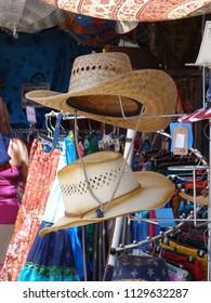 PORTLAND, OREGON - JUL 6, 2018 - Summer hats on sale at the Waterfront Blues Festival, Portland, Oregon
