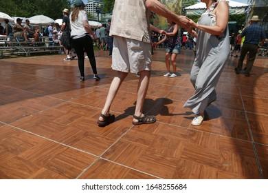 PORTLAND, OREGON - JUL 7, 2019 - Dancers enjoy cajun zydeco music at the Waterfront Blues Festival, Portland, Oregon