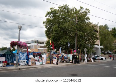 PORTLAND, OREGON - JULY 10 2018: Protesters in front of their camp next to the Portland ICE (U.S. Immigration and Customs Enforcement) building