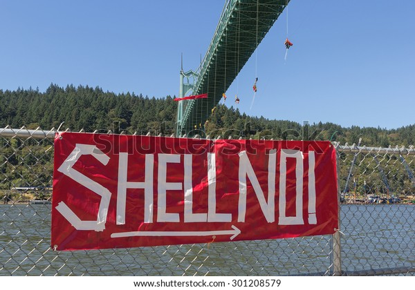 PORTLAND, OREGON - JULY 29, 2015: Greenpeace USA activists rappelled off St Johns Bridge in Portland OR in protest and preventing Shell Oil Icebreaker Vessel from leaving for oil drilling in the Artic