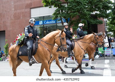 PORTLAND, OREGON - JUNE 11, 2016 Grand Floral Parade. Portland police members