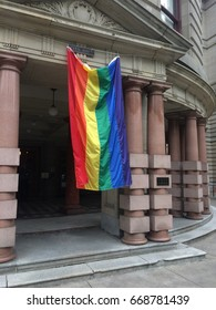 PORTLAND OREGON, JUNE 26 2016, The main entrance to the Portland City Hall building, with a rainbow LGBT flag hanging down in support of Pride month.