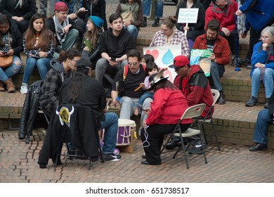 PORTLAND, OREGON MARCH 10 2017, A drum circle at a Protest of the Dakota Access Pipeline (DAPL) in the downtown Terry Shrunk Plaza park.