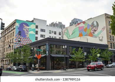 Portland, Oregon - May 2, 2019: Buildings with murals in downtown Portland.