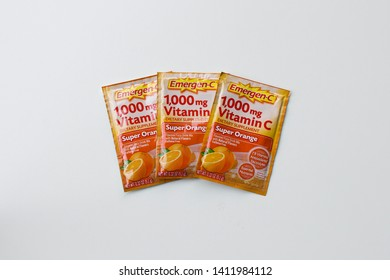 Portland, Oregon - May 28, 2019: Emergen-C Super Orange flavor dietary supplement fizzy drink mix with 1000mg Vitamin C, 0.32 ounce powder packets.