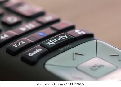 Portland, Oregon - May 8, 2019: The Xfinity X1 TV remote control with voice commands functionality. Xfinity is a trade name of Comcast Cable Communications, LLC.