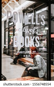 Portland, Oregon - Nov 10, 2019 : Powell's Books logo on shop-window, where is the worlds largest used and new bookstore
