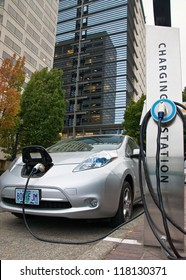 PORTLAND, OREGON - OCTOBER 11: The Nissan Leaf, a new model of electric car, is charging outside the World Trade Center-Conference Center in downtown Portland, Oregon on October 11, 2012.