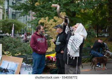 PORTLAND, OREGON OCTOBER 12 2016, Brand Nu Thornton blows his shofar towards the courthouse in support of the defendants in the trial of the armed occupation of the Malheur National Wildlife Refuge.