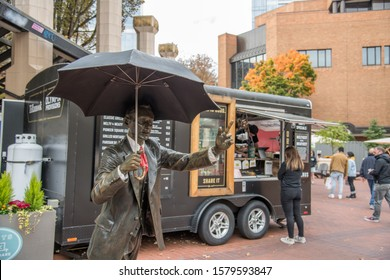 Portland, Oregon: October 13, 2019:  Food trucks in the city of Portland.    The population of Portland is 653,115.