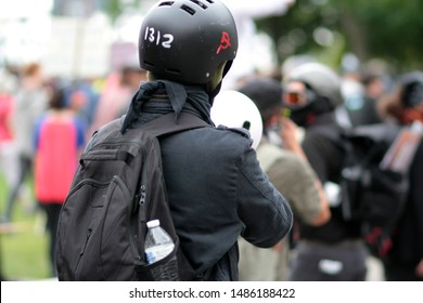 Portland, Oregon. Saturday, August 17, 2019. Antifa supporter at a rally to protest the Proud Boys and Patriot Prayer rally.