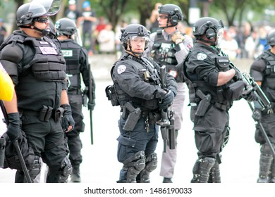 Portland, Oregon. Saturday, August 17, 2019. Police officers in body armor out in force, overseeing a crowd of protestors.