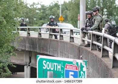 Portland, Oregon. Saturday, August 17, 2019. Police block the Hawthorne Bridge to prevent protestors from crossing the river.