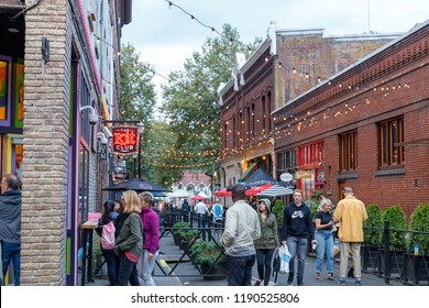 Portland, Oregon - Sep 16, 2018 : View of 3rd Avenue in downtown Portland lined club and bars