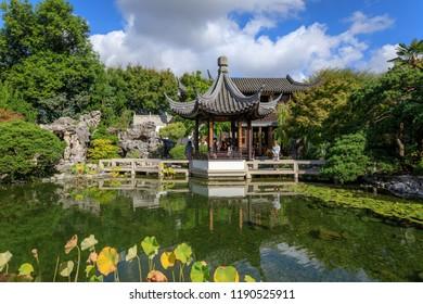 Portland, Oregon - Sep 21, 2018 : Lan Su Chinese Garden in summer season. Garden Pavilion reflects in pond - Shutterstock ID 1190525911