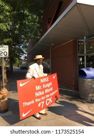 Portland, Oregon -September 05 2018: An African American man in a suit holds a sign thanking Nike for their latest Just Do It ad campaign with controversial football star Colin Kaepernick