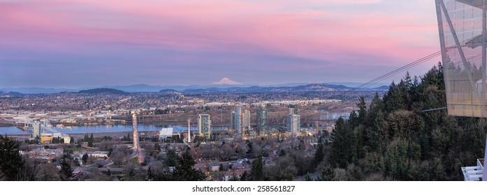 Portland Oregon South Waterfront with Ross Island Bridge Tilikum Crossing and Mount Hood during Alpenglow Sunset Panorama