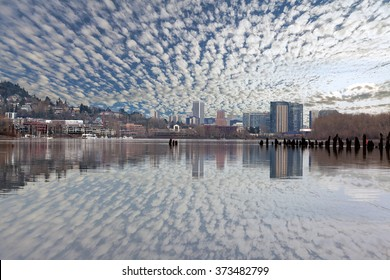 Portland Oregon and South Waterfront Skyline Reflection on Willamette River with Blue Sky and White Clouds