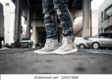 "Portland, Oregon / United States - March 24 2017: Yeezy 750 ""OG"" with some stylish distressed jeans"