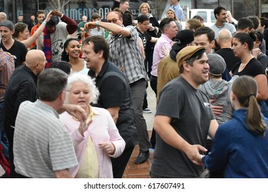 Portland, Oregon, USA 04.02.2017 : A Large Group Of People Dancing In Downtown Portland Oregon During Daylight Outside In The Spring