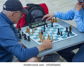 Portland, Oregon USA - April 20, 2015:  Two men playing chess in Director Park Portland Oregon on lunch hour with a timer shot from above