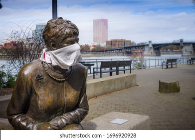 PORTLAND, OREGON USA - April 7, 2020: Statue of former mayor of Portland Oregon adorned with a scarf signifying a response to the covid-19 pandemic.