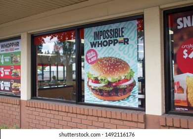 Portland, Oregon, USA - Aug 30, 2019: Impossible Whopper sandwich advertising is seen at a Burger King restaurant in Portland. The sandwich is made with an Impossible brand plant-based patty.