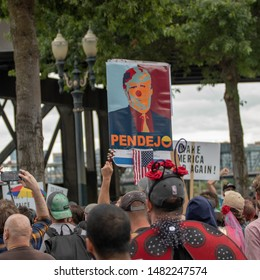 "Portland, Oregon / USA - August 17 2019: A protest sign depicts Donald Trump as a simple clown with the Spanish word ""Pendejo,"" meaning ""Stupid,"" because Donald Trump is stupid, and a clown."