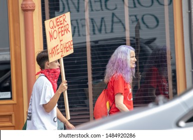 """Portland, Oregon / USA - August 17 2019: Counter-Protest against Proud Boys. Sign reads """"Queer No Fear / Hate Not Here"""""""