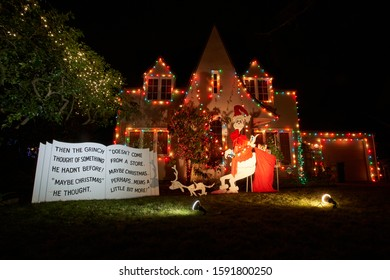 """Portland, Oregon, USA - Dec 17, 2019: The """"Grinch House"""" on Peacock Lane in southeast Portland decorated with festive lights and displays for the holiday season."""
