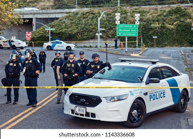 Portland, Oregon / USA - July 20, 2018: ICE cops stand in a line behind police tape at the Occupy ICE camp