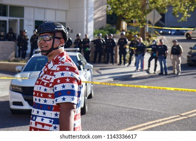 "Portland, Oregon / USA - July 20, 2018: Patriot Prayer member Tusitala ""Tiny"" Toese stands in front of police tape line at Occupy ICE camp"