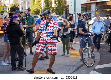 "Portland, Oregon / USA - July 20, 2018: Patriot Prayer member Tusitala ""Tiny"" Toese dancing and arguing with Occupy ICE protesters."