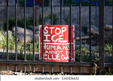 Portland, Oregon / USA - July 20, 2018: A political sign at the Occupy ICE camp that tells people to stop ICE and that humans cannot be illegal