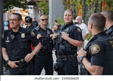 Portland, Oregon / USA - July 20, 2018: Police monitoring the Occupy ICE protest