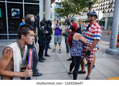 "Portland, Oregon / USA - July 20, 2018: Patriot Prayer member Tusitala ""Tiny"" Toese faces off with Occupy ICE protesters near the OccupyICE camp"