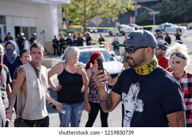 Portland, Oregon / USA - July 20, 2018: Washington state senate candidate and Patriot Prayer member Joey Gibson argues with Occupy ICE protesters on the street