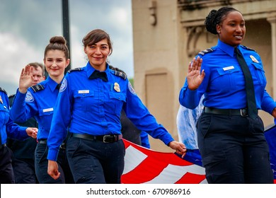 Portland, Oregon, USA - June 10, 2017: Transportation Security Administration in the Grand Floral Parade, as it stretched through the rain, during Portland Rose Festival 2017.